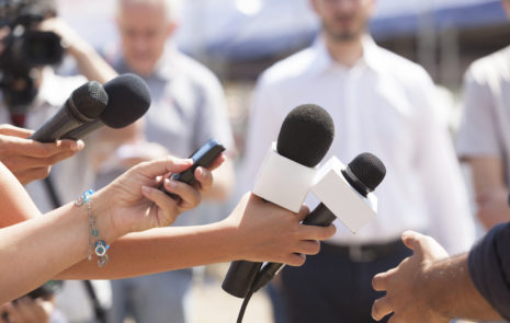 Reporters with microphones