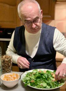 French chef preparing salad