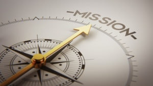 "Compass pointing to the word ""Mission."""