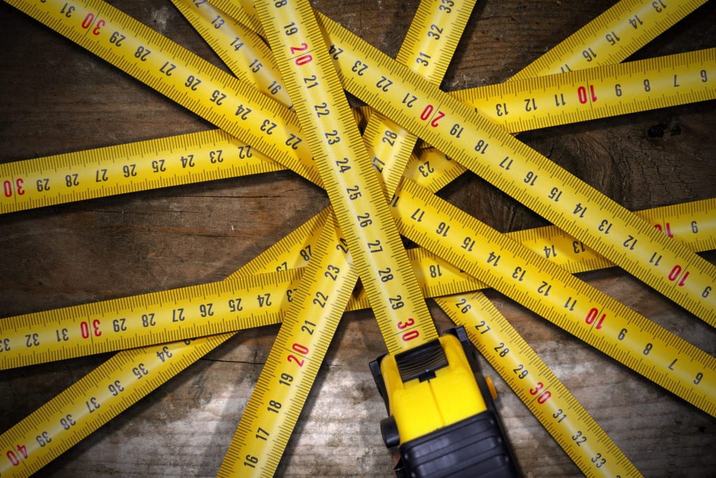 How best to manage and track success of best performing content Group of rulers/measuring sticks