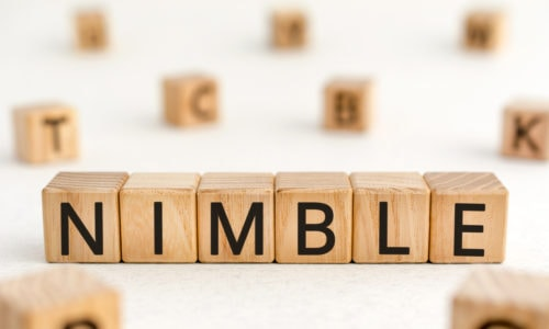 "Content marketing during a crisis Building blocks assembled to show the word ""nimble."""