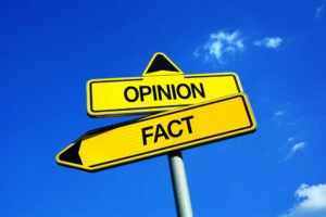 "Roads signs showing ""opinion"" and ""fact"" pointing different ways."