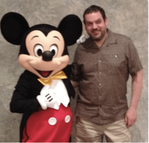 George Stenitzer with Mickey Mouse