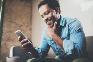 Man looking at phone and smiling