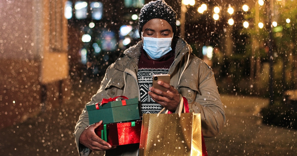 happy holidays - Man with mask and holiday presents