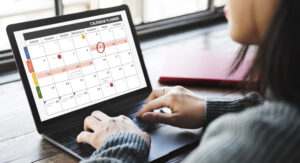 Woman looking at calendar on laptop