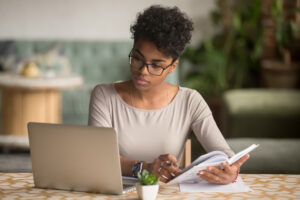 Woman doing research before ghostwriting thought-leadership content.