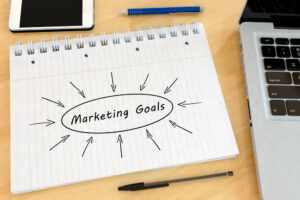 """Piece of paper that says """"marketing goals"""" - Marketing team"""